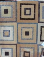 Blue and cream sort of courthouse step quilt