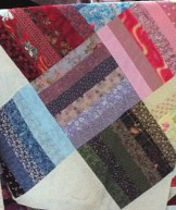 One piece of fabric of every fabric I owned at the time of making this quilt