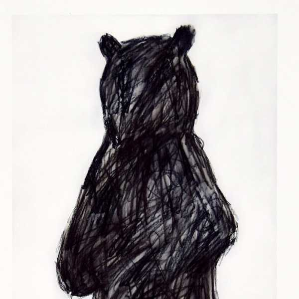 charcoal silhouette of a black bear on light grey background, detail