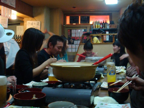 A family gathered around the nabe.