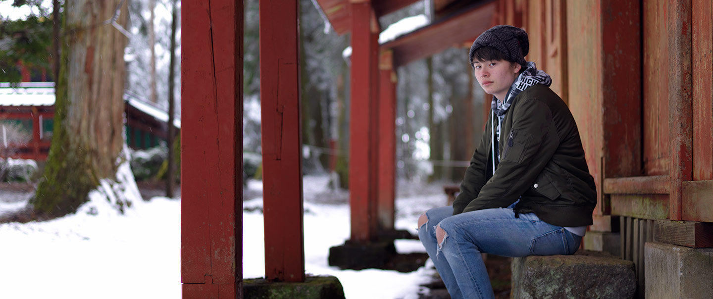 Joe sitting outside a shrine in Nikko