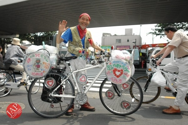 Cheerful cycling man with gay smile, his name is Captain flower (5)