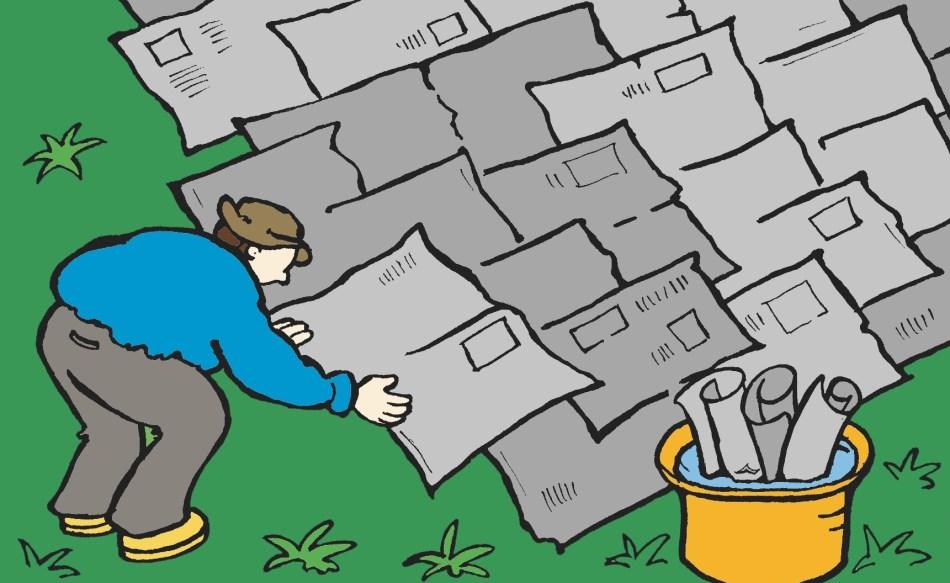 Illustration montrant la pose d'une barrière de papier journal sur un gazon.