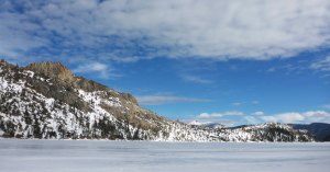 Frozen lake and snow-covered mountains
