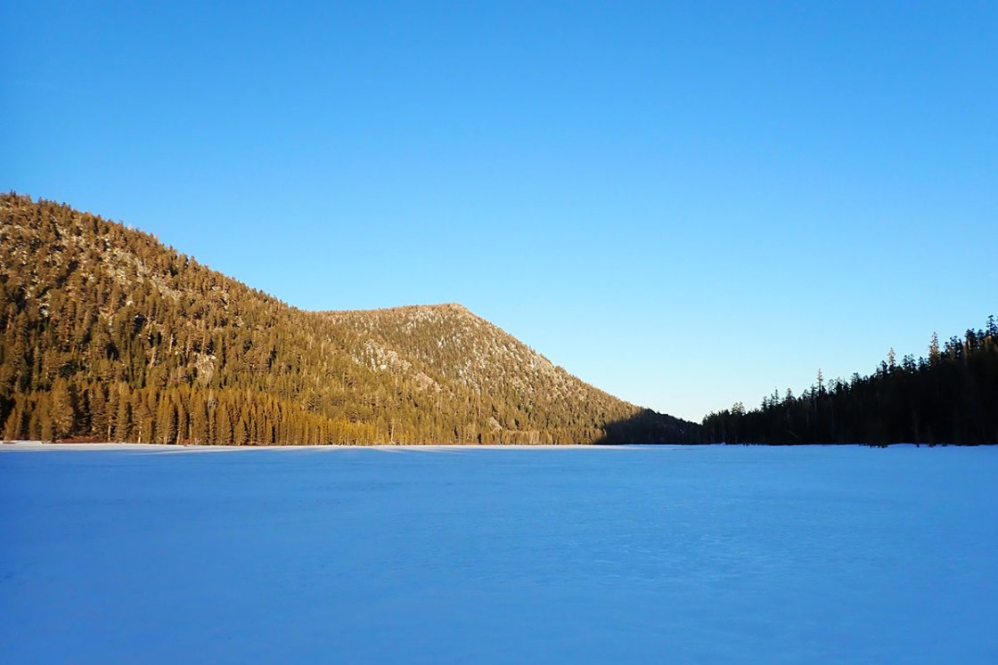 Frozen lake surrounded by mountains