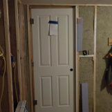 Put a new door b/w east bed and bathroom