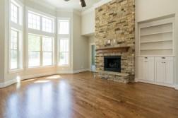 Stone fireplace & custom built-in