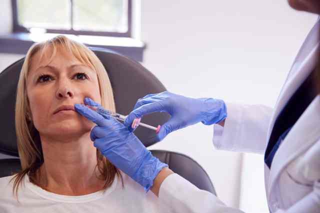 mature women getting dermal filler injections