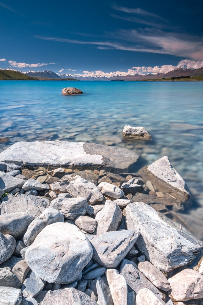 Fine Art Photography - Boulders and crystal blue water at Lake Tekapo