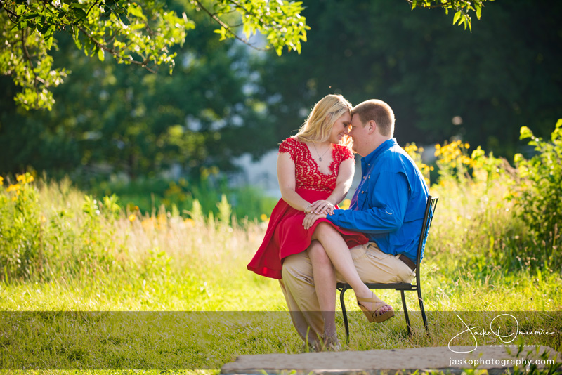 Engaged Couple Sitting On Chair for Their Engagement Session in Chicago