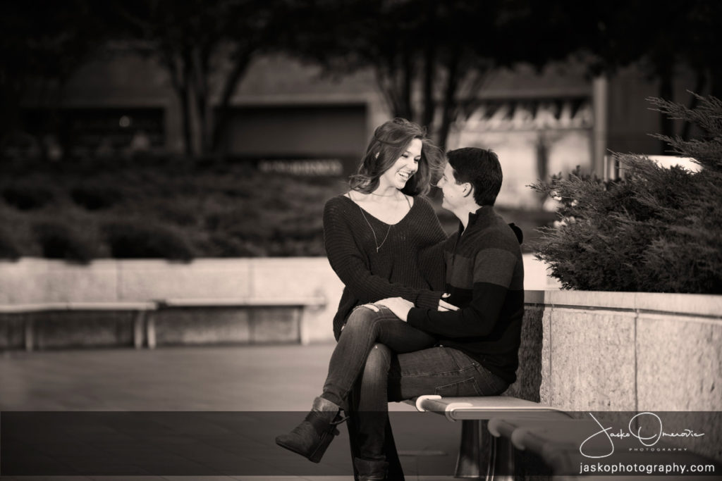 Engaged Couple Sitting On a Bench