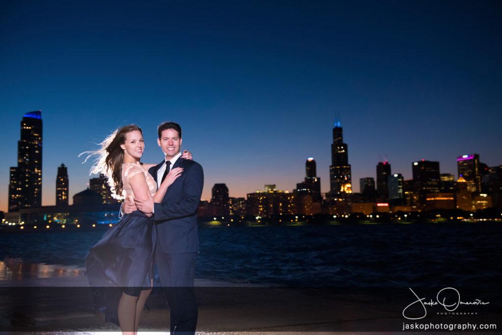 Engaged Couple Before Chicago Skyline