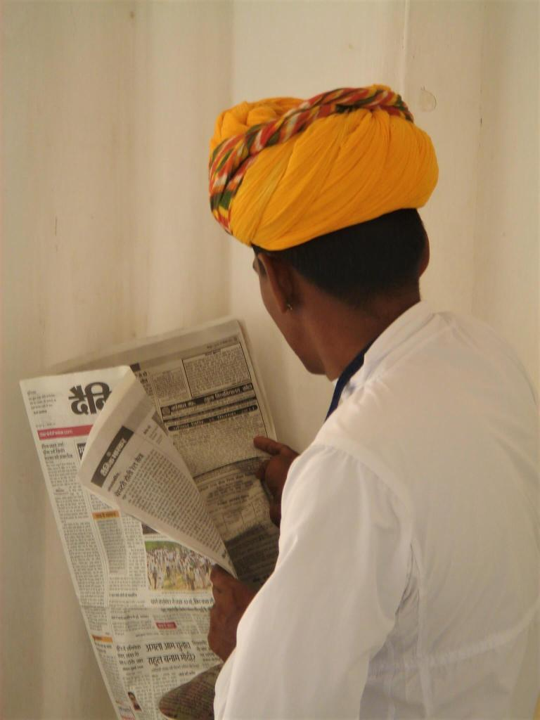 Jasmine Trails newsletter sign up page. In the image is a man in a traditional turban reading a newspaper in Jodhpur