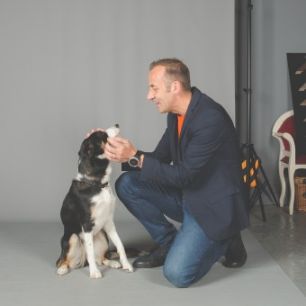 picture of Jason Allison and his dog Tess in the studio