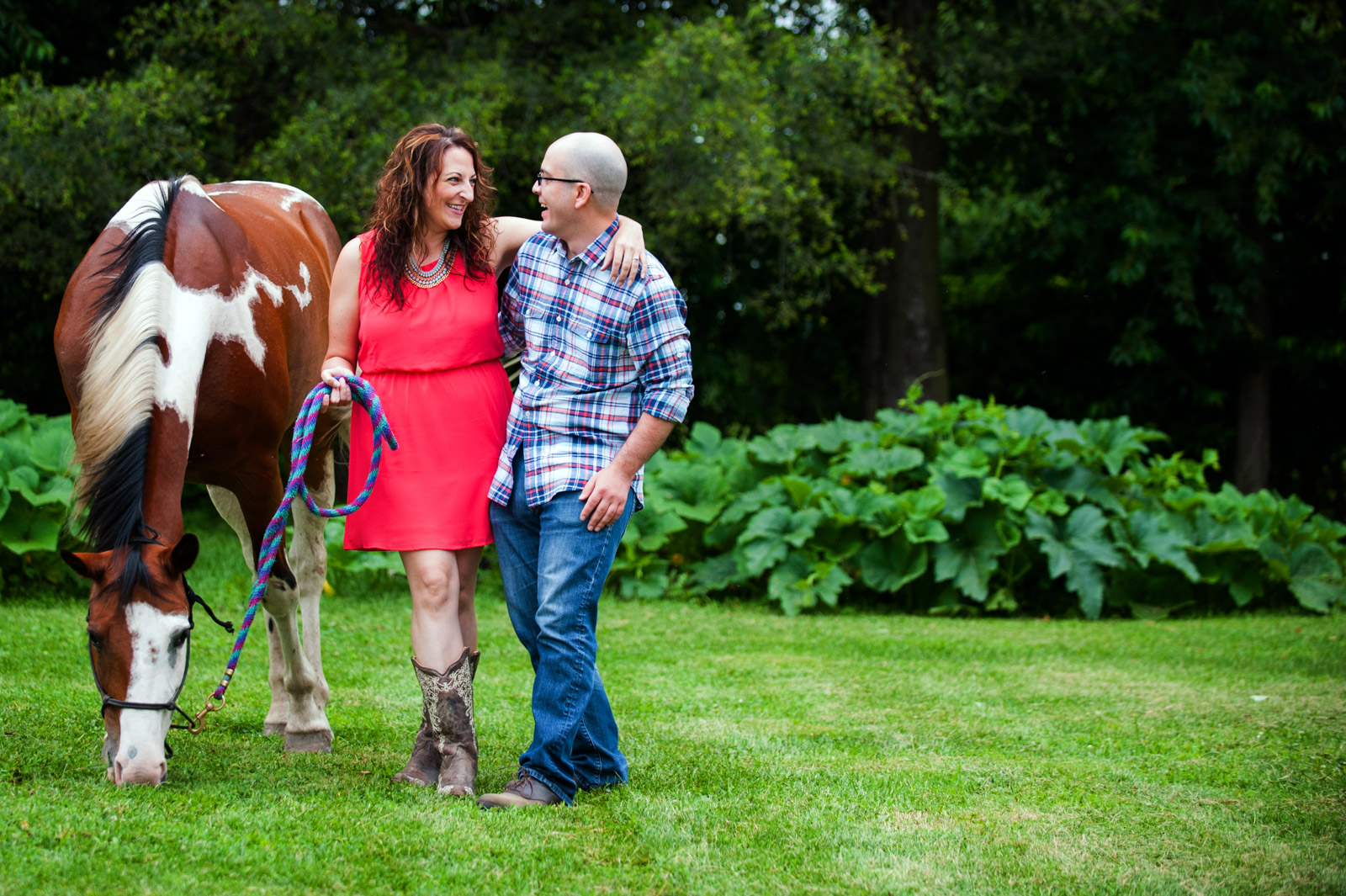 Farm engagement session photo with engaged couple and horse