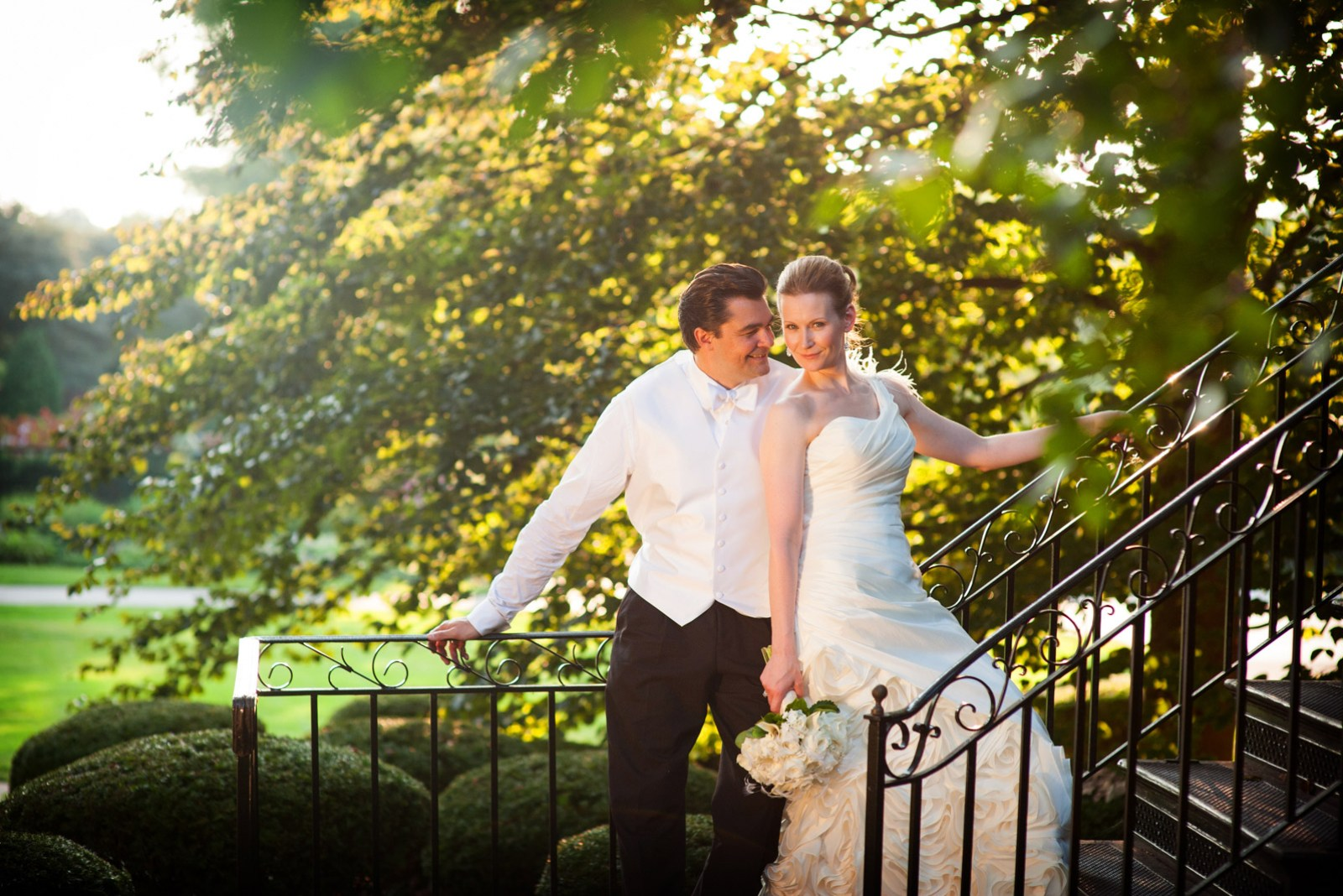 Fall wedding at Cantigny Park in Wheaton featuring a bride and groom under trees