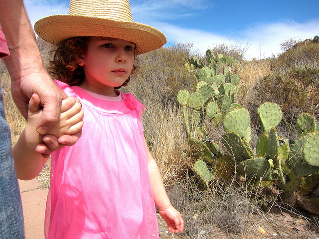Anais holding dad's hand, walking Big Bend