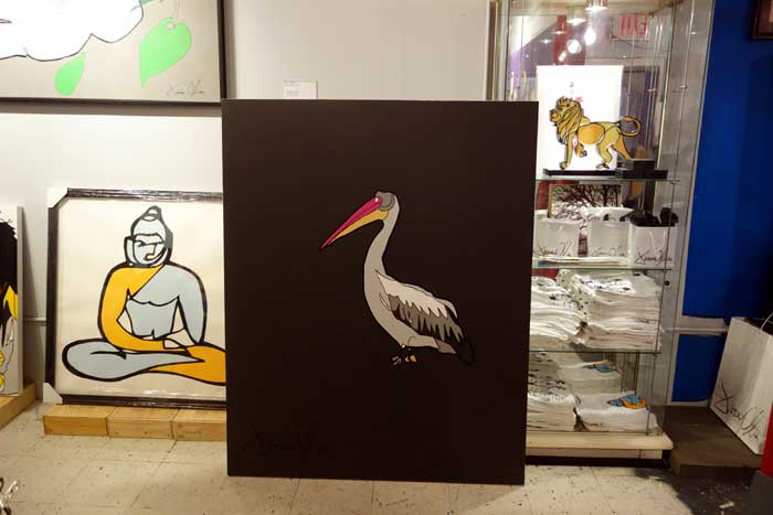 Pelican 2014 painting alongside a Buddha work on paper and Lion Sculpture in Jason Oliva's art studio