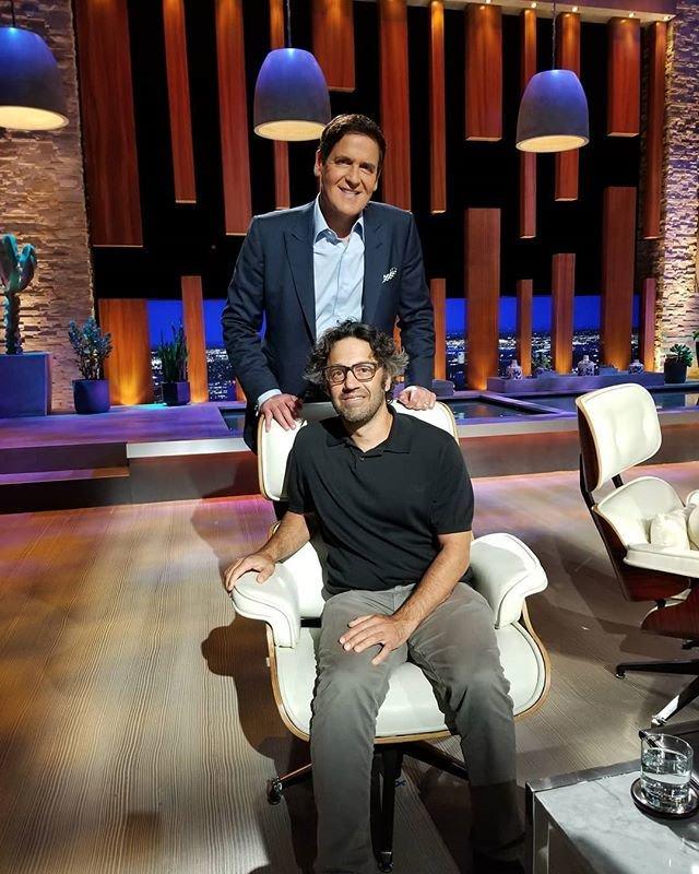 Jason Oliva on Shark Tank set with Mark Cuban