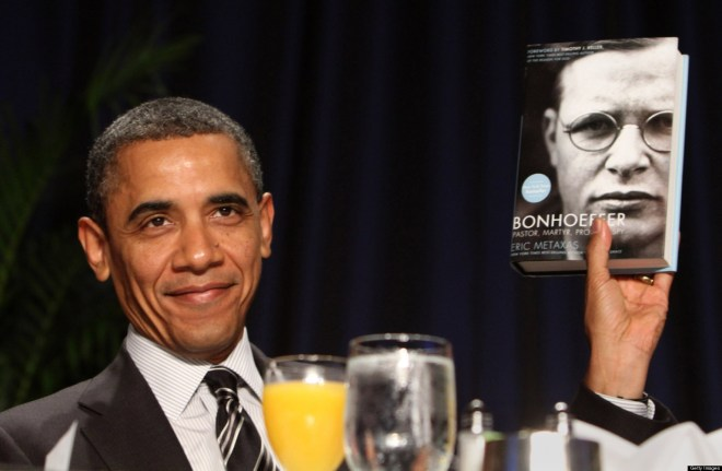 WASHINGTON, DC - FEBRUARY 2:  (AFP OUT) U.S. President Barack Obama holds up a book given to him by author Eric Metaxas, who was the keynote speaker at the National Prayer Breakfast February 2, 2012 in Washington, DC.  Obama also spoke, defending his economic policies in an echo of his recent State of the Union address. (Photo by Chris Kleponis-Pool/Getty Images)