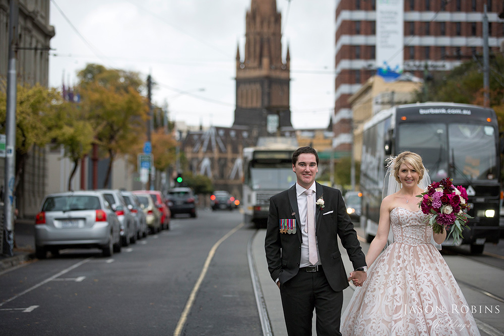 Bride and Groom walking down street in Melbourne CBD