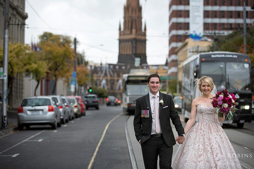 Bride and Groom walking down street in Melbourne CBD