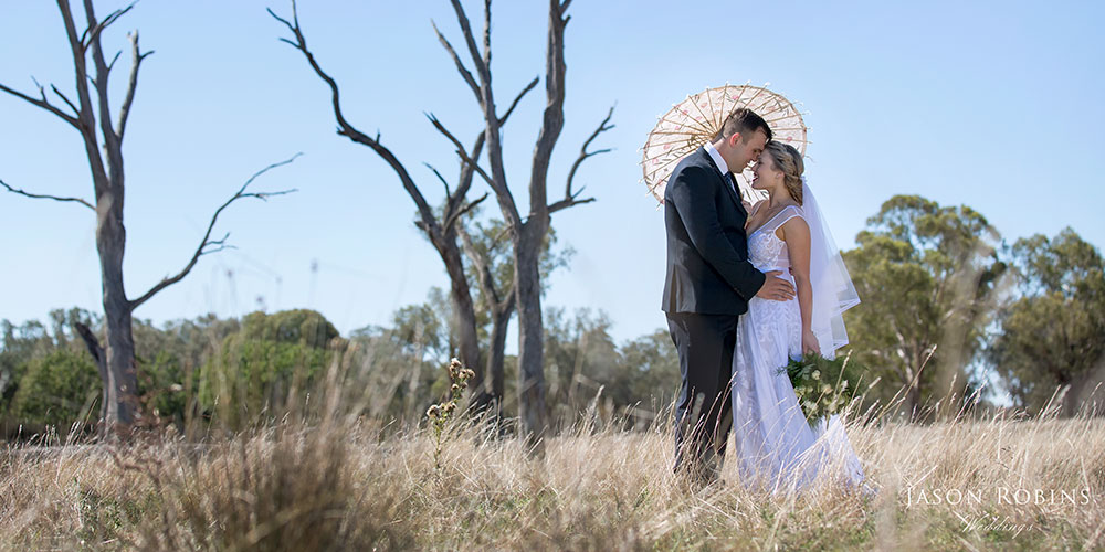 Bride and Groom in grass field
