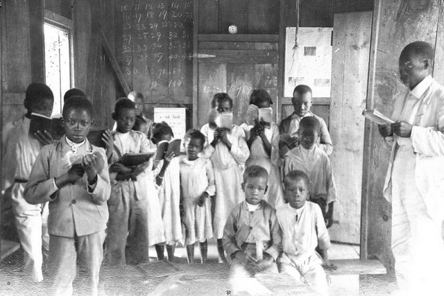 jamaican-primary-schoolhouse-with-children-and-their-teacher_early-20th-century-photograph
