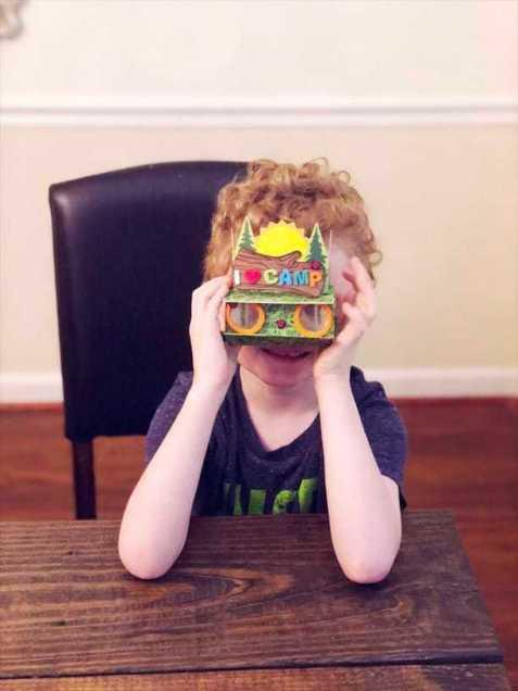 Kids Night In Box boy playing with craft binoculars
