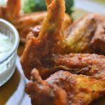 This easy buffalo wings recipe makes for the perfect party appetizer or snack! These crispy and spicy wings will feed a crowd at your football party and Christmas party too! Be sure to check out this easy appetizer recipe.