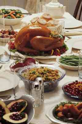 thanksgiving side dish recipes - table set with turkey and all the sides