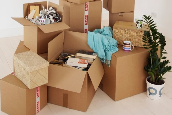 How to declutter before moving with moving boxes.