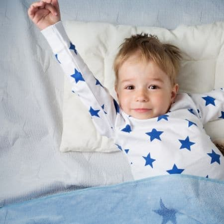 child waking up for school in the morning