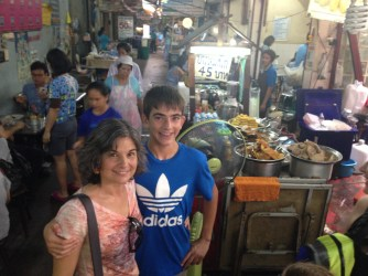 A typical Thai market alleyway with food vendors and such