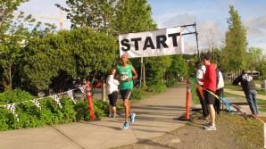 Men's 5K Winner, Mike Mammo crosses the finish line