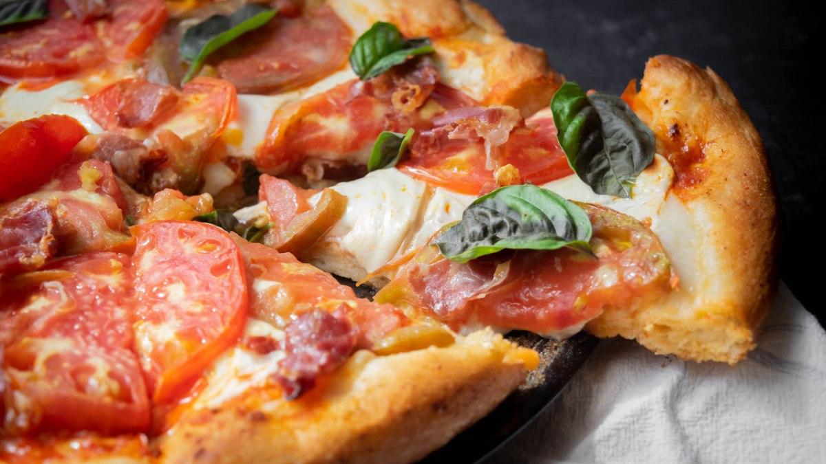 Harissa Pizza with Smoked Mozzarella, Heirloom Tomatoes and Prosciutto