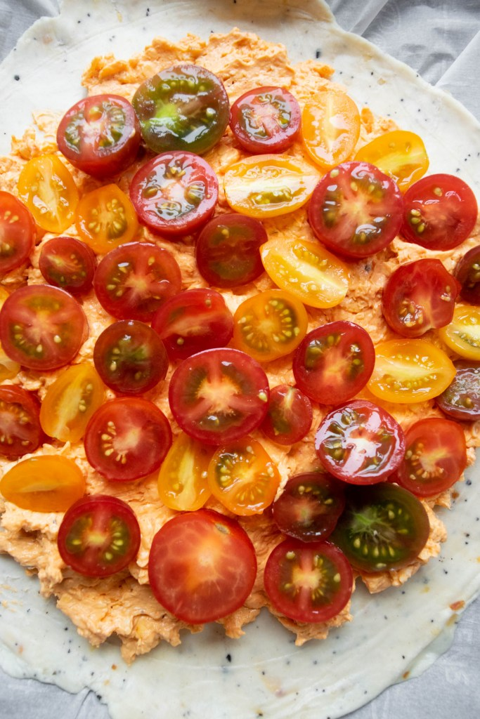 everything bagel galette dough with pimento cheese and tomatoes