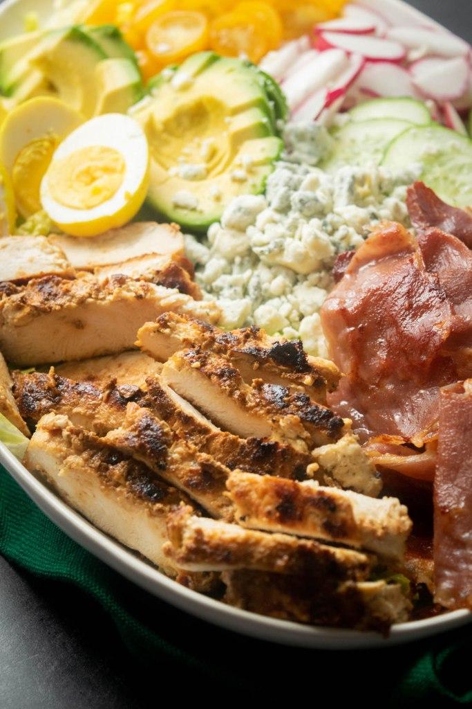 chicken prosciutto pickled egg cobb salad close up