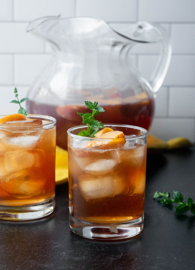 pitcher of peach infused vodka and tea
