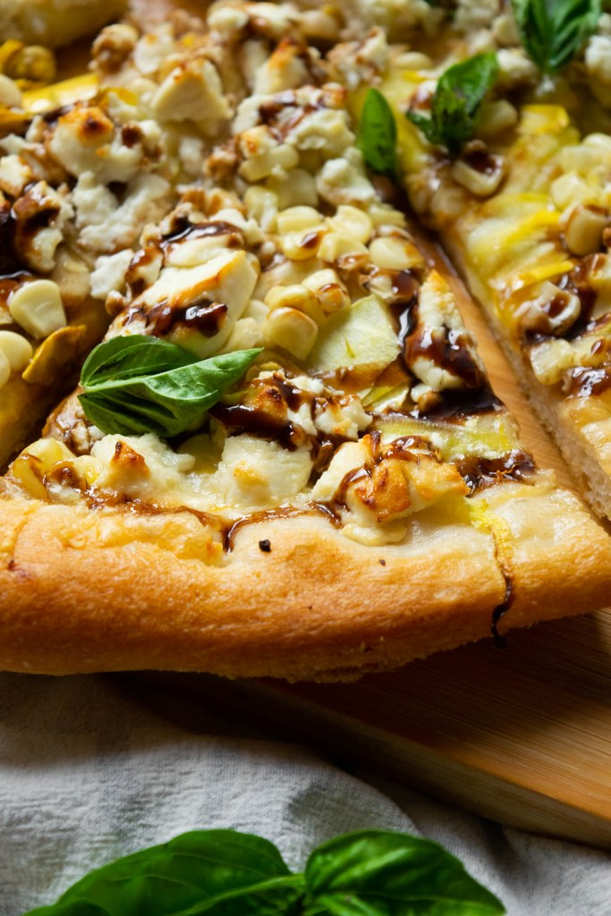 closeup slice of garden veggie pizza