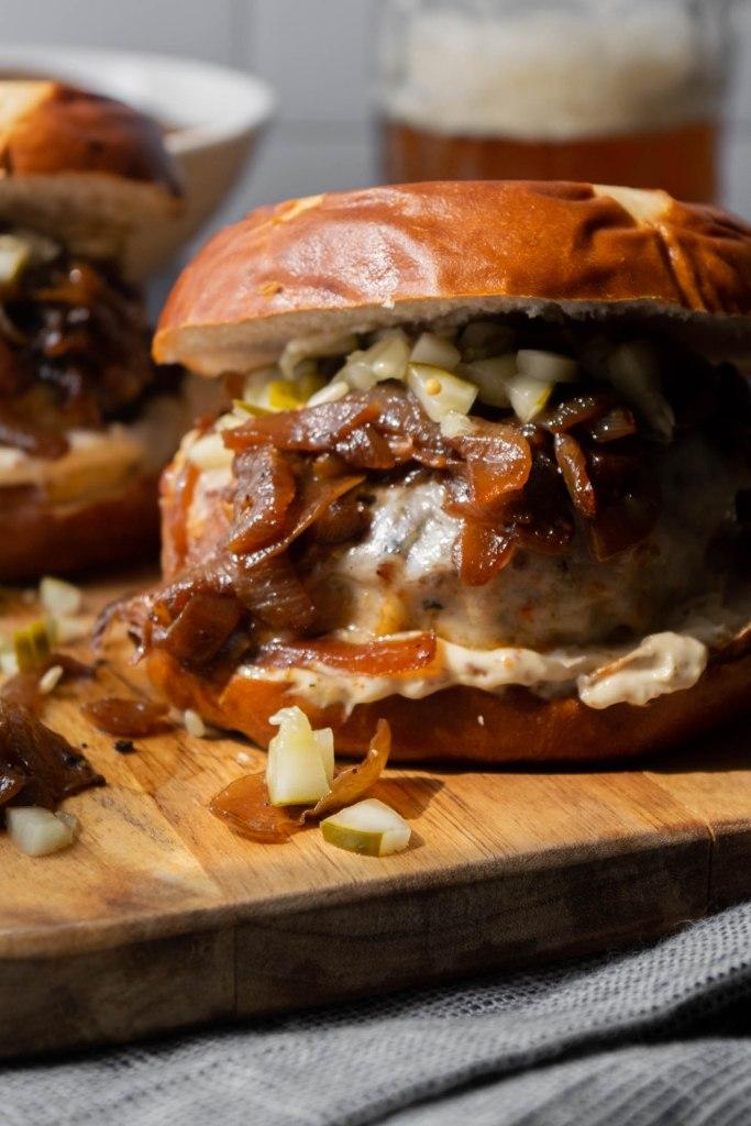 Schnitzel Burgers with Muenster Cheese on Pretzel Buns