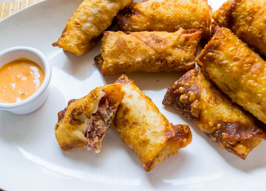 plate of egg rolls with russian dressing
