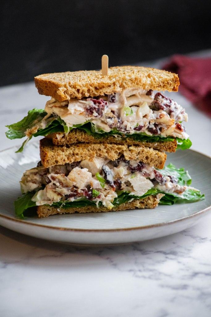 bowl of cranberry pecan chicken salad sandwich