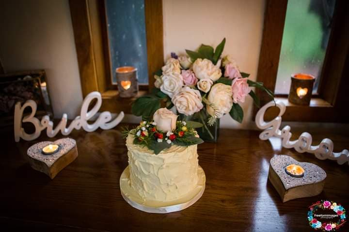 Intimate rustic ganached wedding cake with fresh flower topper