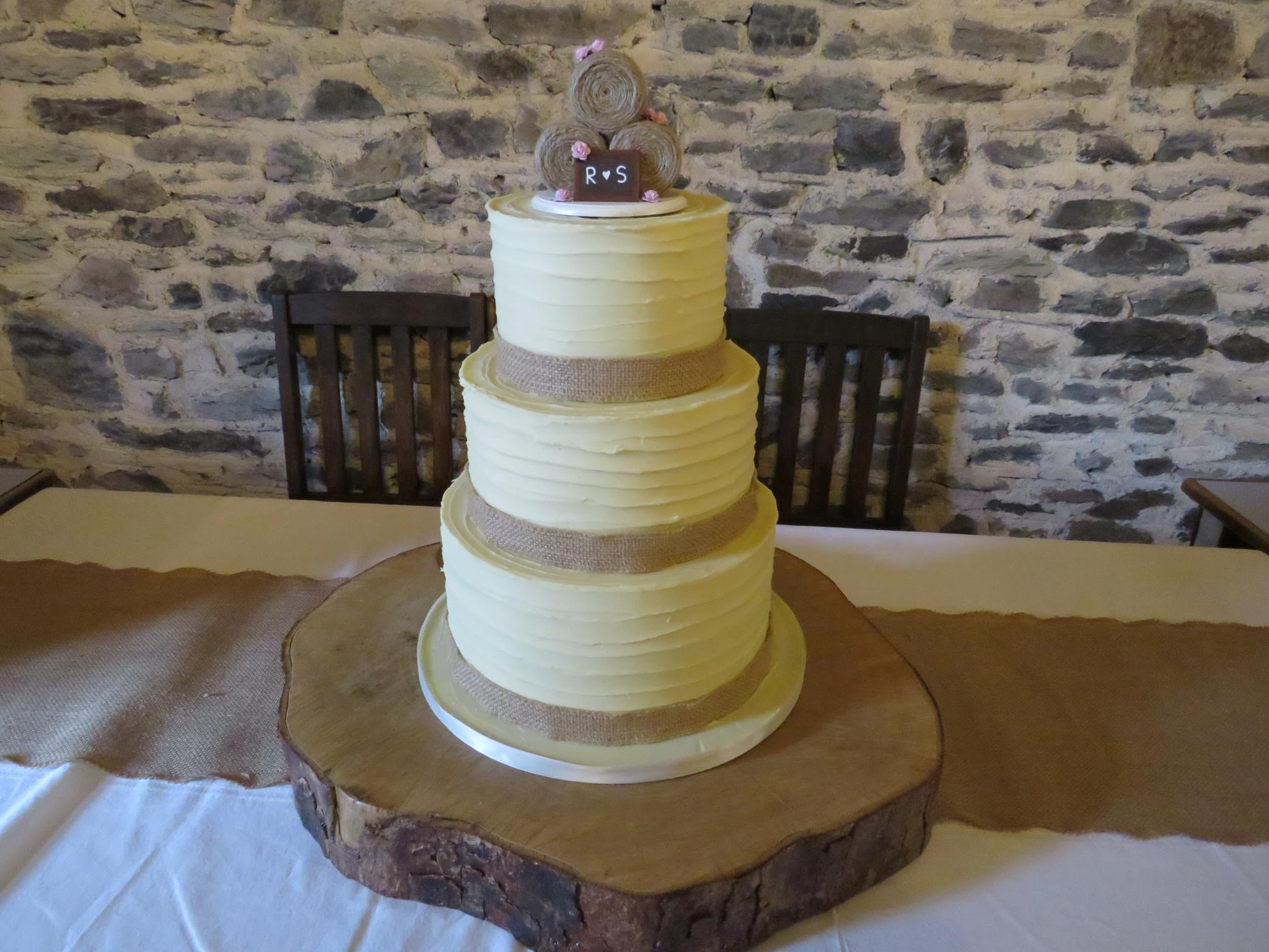 3 tier buttercream wedding cake with hay bales on top