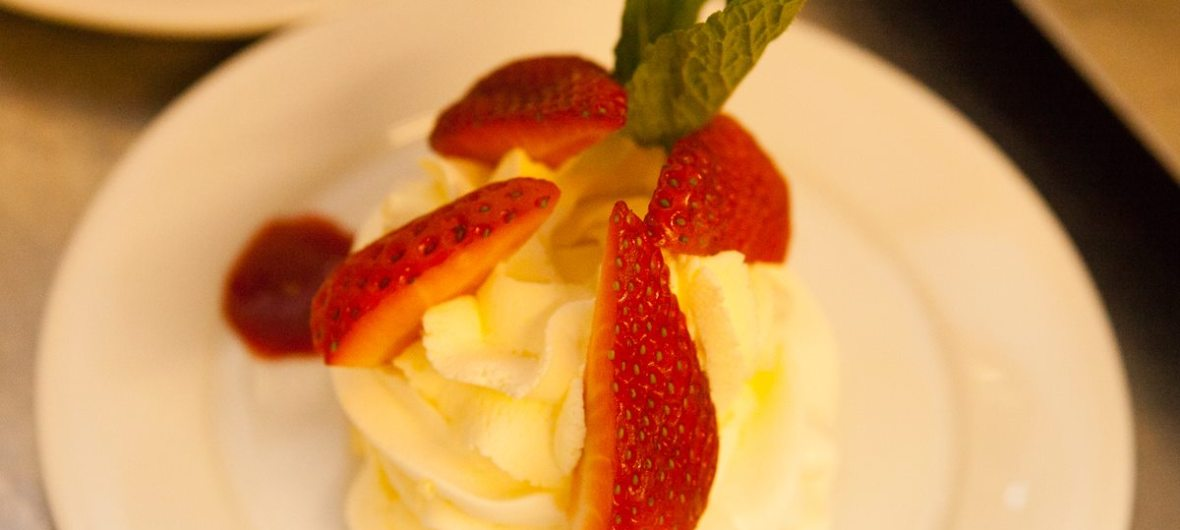 Jax's Cakes 'N' Bakes -Pavlova topped with whipped cream & fresh strawberries