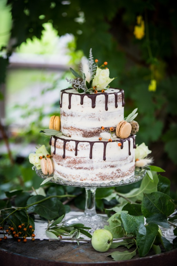 Semi naked two tier wedding cake with macaroons & chocolate drips