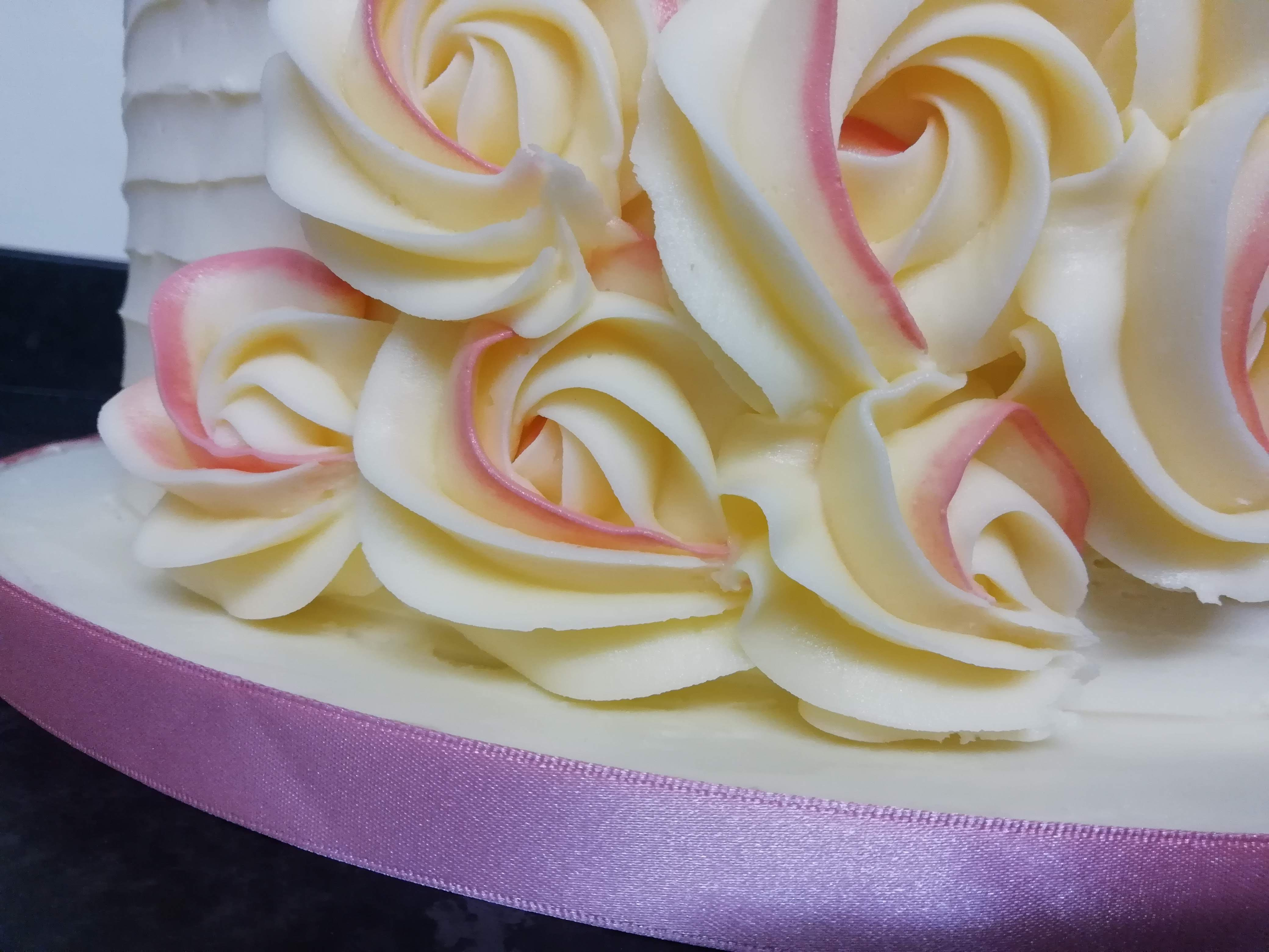 Close up of buttercream piped roses