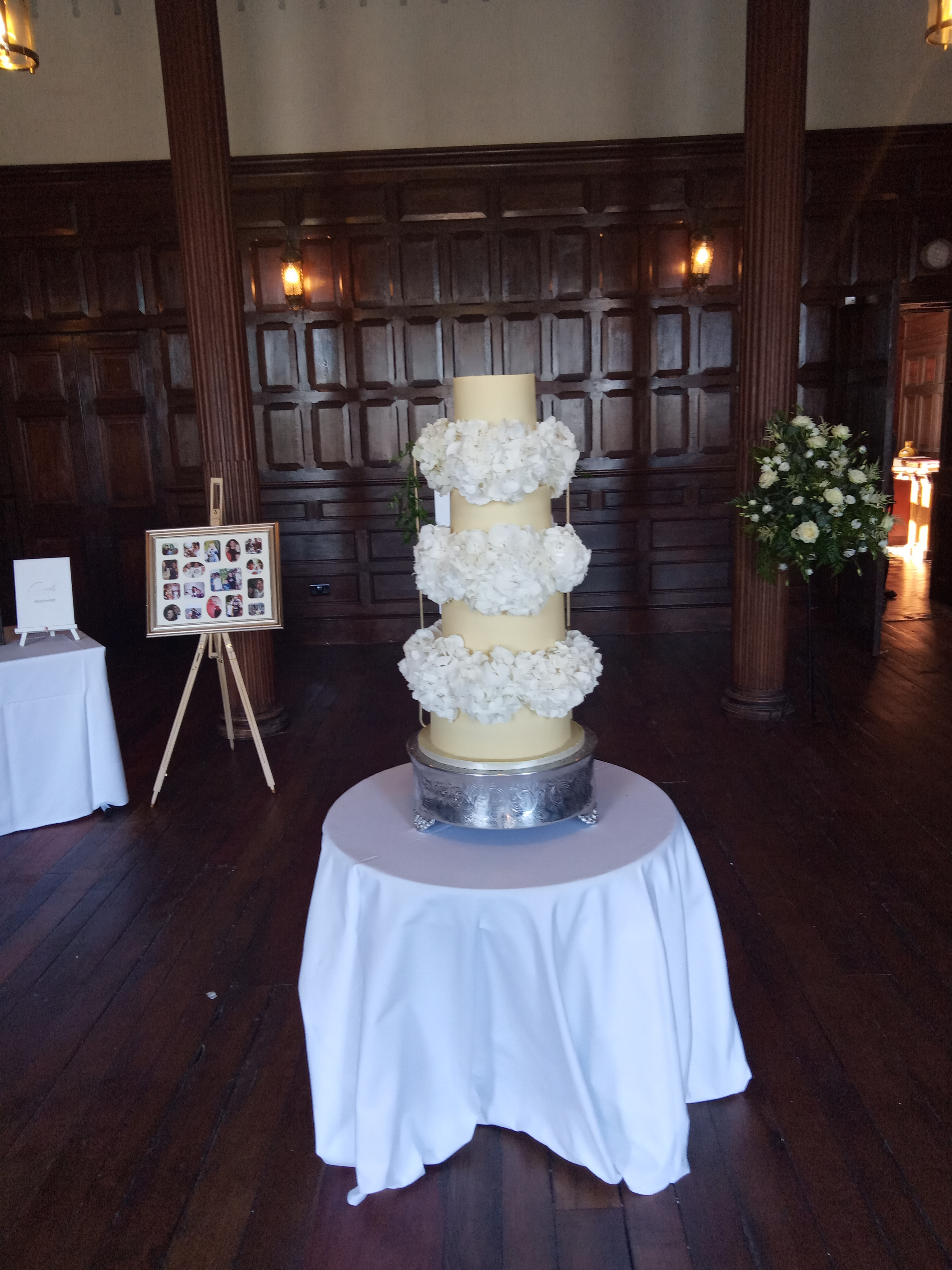 4 tier ganached wedding cake with hydrangea in separators