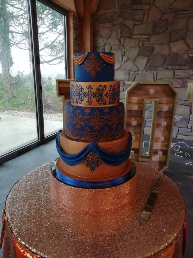 5 tier rose gold & royal blue wedding cake